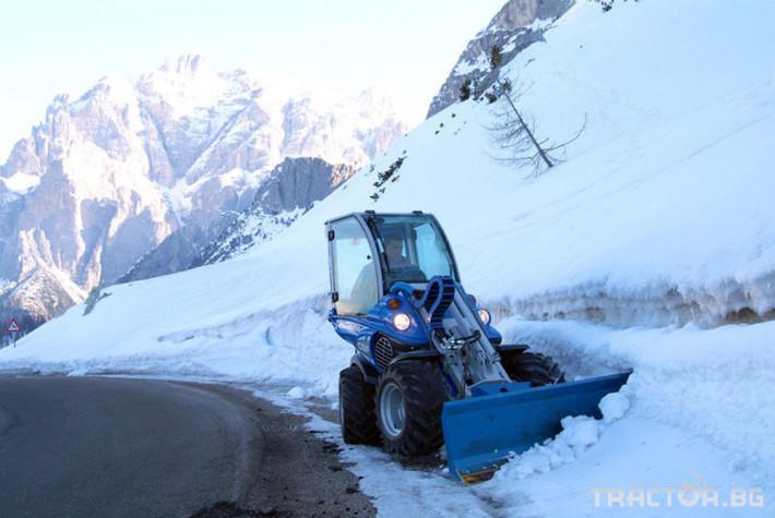 Телескопични товарачи Мини челен товарач Multione с гребло за сняг 1